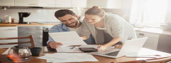 Man and woman reviewing debt