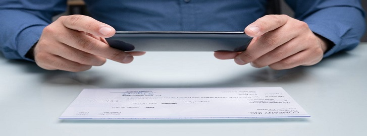 Person taking picture of a check with a smartphone