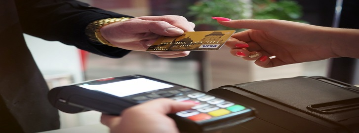 Person giving credit card to merchant